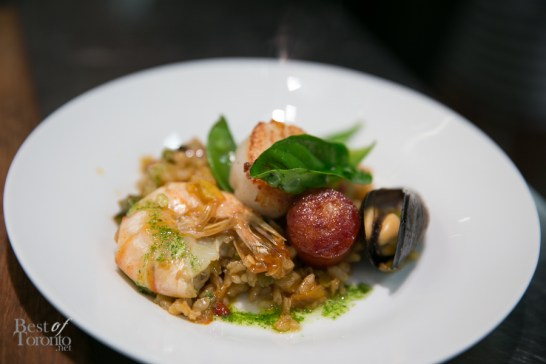 Valencian Spanish paella with baby clam, mussel, calamari, shrimp, chicken and grilled chorizo