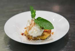 Cinnamon sugar grilled pineapple slice topped with housemade coconut gelato and a pink pepper sauce by Felipe Faccioli, Patrick Fraser and Tulio Lessa (MATA)