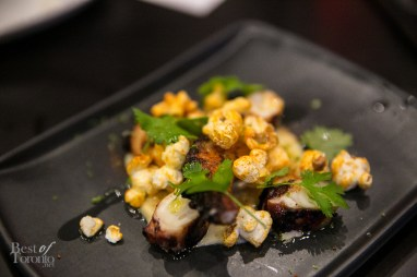 Octopus served as a snack with popcorn, lime, cilantro