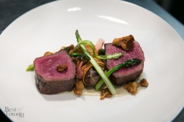 Ontario 60 day aged strip loin, shallot, morels, potato, braised shin, leeks, asparagus and soubise.