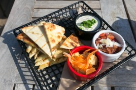"""Breads n Spreads"" with artichoke asiago dip, bruschetta, and a weekly hummus served with grilled naan bread"
