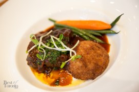 Braised beef short ribs served with horseradish potato croquette and seasonal vegetables