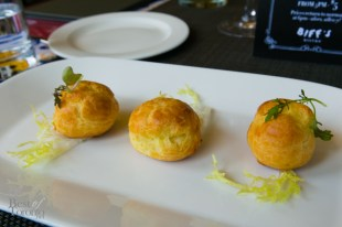 gougère - a choux pastry filled with goat cheese mousse infused with herb garlic and lemon