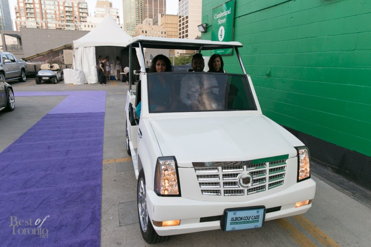 Guests got chauffeured in Cadillac golf carts