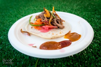 Smoked duck tacos with pickled radish, carrots, crispy fried chicken skin, and a hoisin BBQ sauce on a flour tortilla from Barque Smokehouse