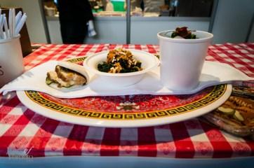 Momofuku Noodle Bar's offerings: pork bun, kale salad, summer ramen