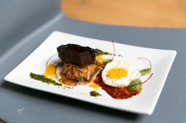 Bibimbap dumpling, sweet & sour braised cabbage, fried hen's egg, scallion-mint 'Chimichurri'