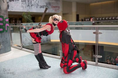 Harley Quinn and Deadpool share a moment with a bat