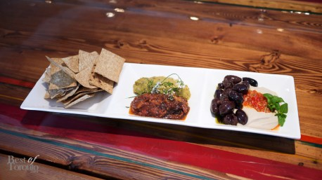 """""""Dip Three Ways"""" with hummus of romano beans, spicy mustard seed, Caribbean eggplant baba ghanoush with cilantro. Served with baked garlic lavash"""