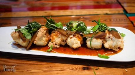 """Chickpea Tempura Tofu"" with pickled brassica and fish mint, shishito peppers, Korean sweet chili sauce, braised burdock root"