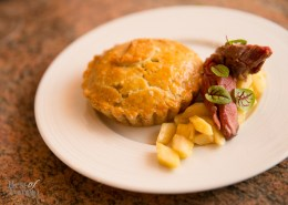Pigeon Pie (circa 1611) is an exquisite flaky cradle embracing rich and saucy squab meat and roasted root vegetables, accompanied by succulent pan-roasted squab breast and parsnip