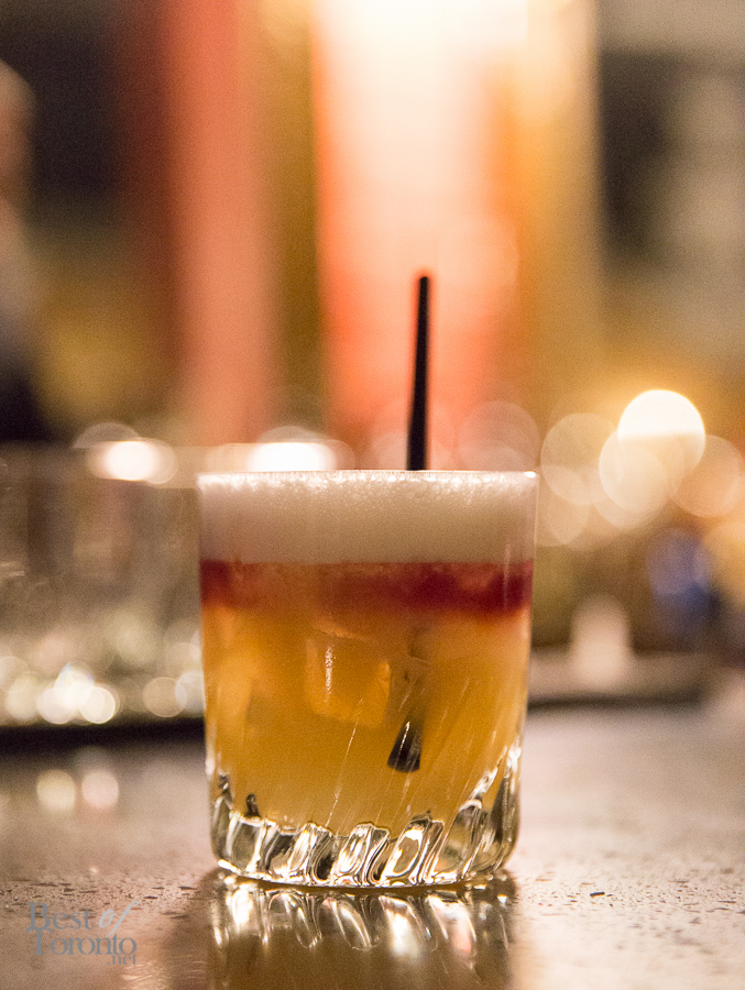 Whisky Sour made with egg whites and a splash of red wine