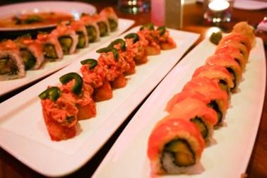 Spicy Tuna on Crispy Sushi Rice and Orange + Black (Salmon, mango, and avocado roll)
