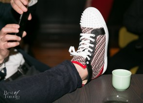 Chef Alvin Leung's Christian Louboutin sneakers. Michael Bonacini snaps a photo with his phone. Photo: Nick Lee