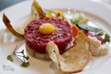 Beef tartare, asian pear, pickled vegetables, quail's egg yolk, toast