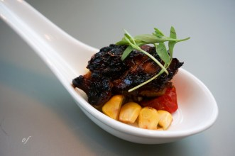 Grilled BBQ chicken, charred scallion barbeque sauce, brown rice, corn, crispy shallot   Photo: Tiffany Leigh