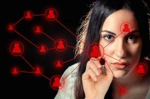 Woman sketching a social network on virtual screen