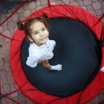 Toddler Jumping on Trampoline