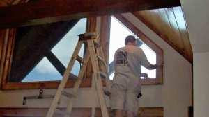 man working on window film installation