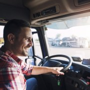Happy truck driver working forlocal freight companies