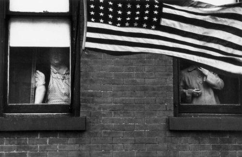 """Parade — Hoboken, New Jersey,"" 1955. Robert Frank via Pace/MacGill"