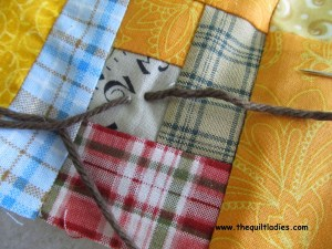How to tie a quilt using yarn