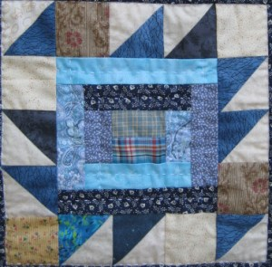 Log Cabin quilt block with triangle edges