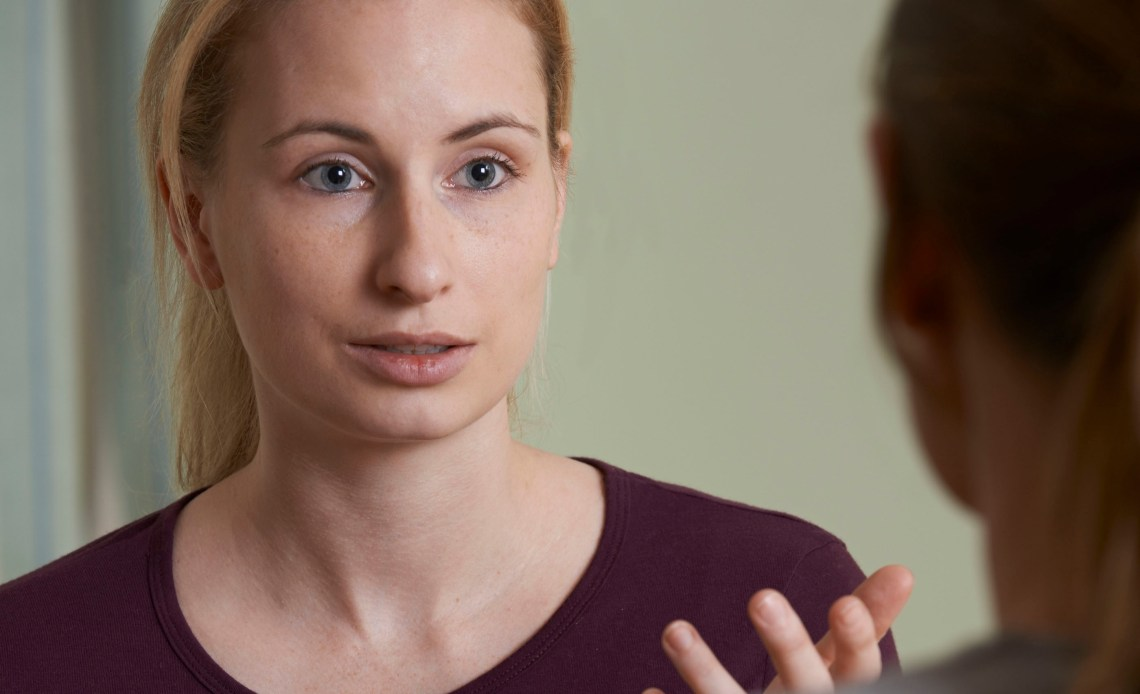 Young Woman Discussing Problems With Counselor