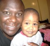Africa-pastor Felix and baby