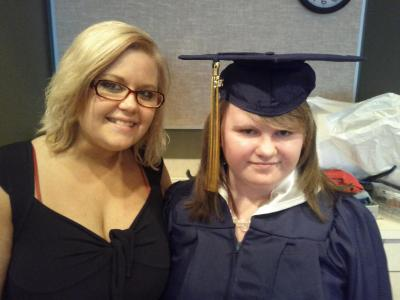 Leah at her graduation with her sister Eden