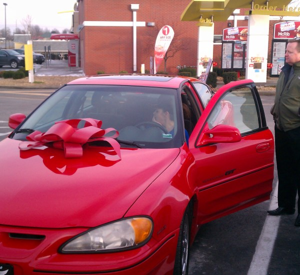 Big Red Bow that the car dealership owners gave us to put on car