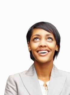 African American woman looking up and smiling