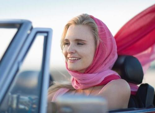 woman driving car with scarf