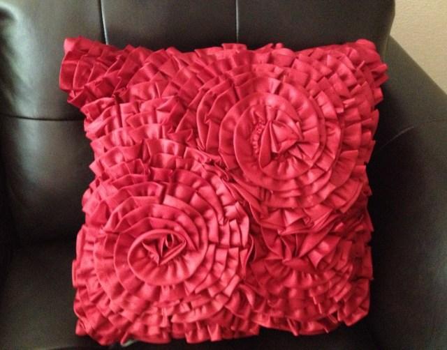 Red-orange ruffled pillow