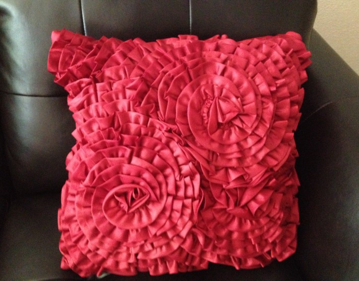 Red-orange ruffled pillow