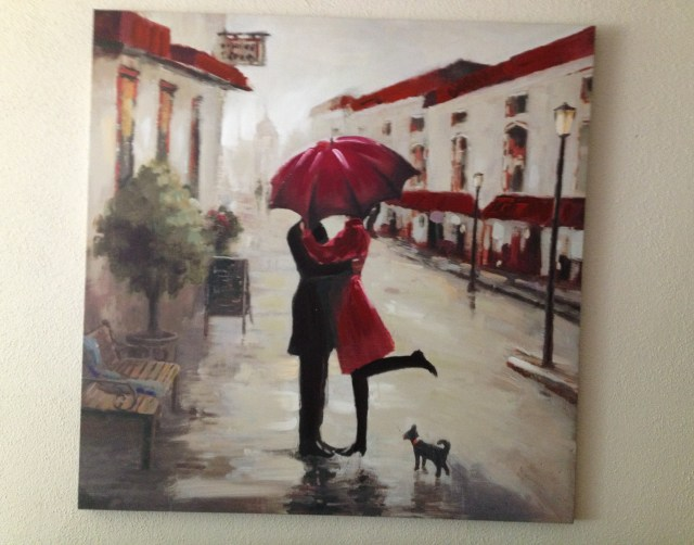 Pic of man and woman kissing in the rain