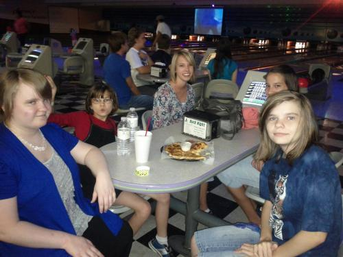 Leah at bowling alley with friends