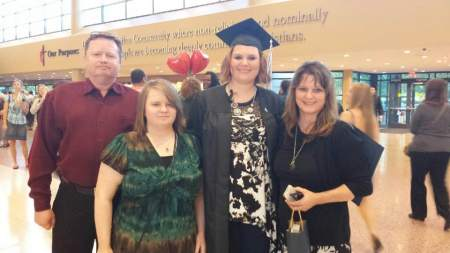 Our family with Heather at her college graduation: Ray, Leah, Heather & me