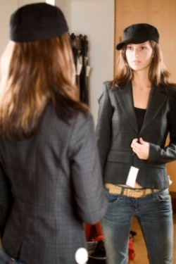 Slender girl looking in mirror