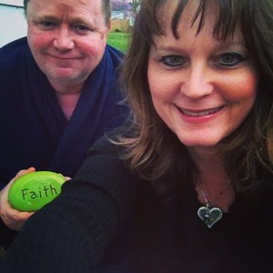 "Ray & me Holding our ""faith"" stone, as we wait for final approval of the VA loan for the home we're buying this year"