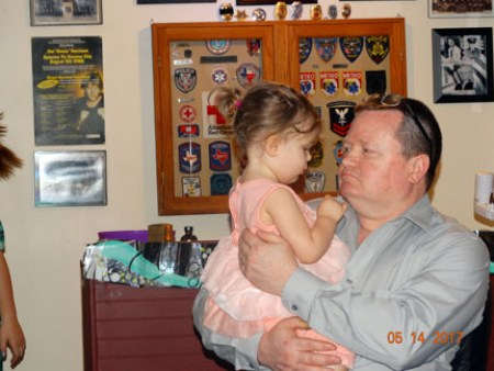 Ray holding our granddaughter Piper--precious!