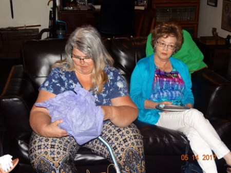 My friend Liz opening a gift from me at the party