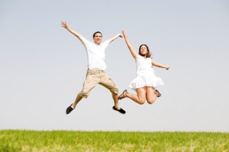 Couple leaping
