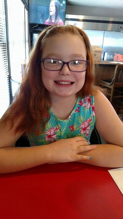 Our beautiful red-headed granddaughter Violet