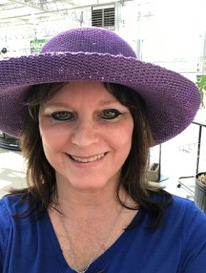 me trying on purple gardening hat, just for fun