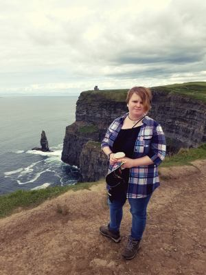 Leah with her coffee at the Cliffs of Moher