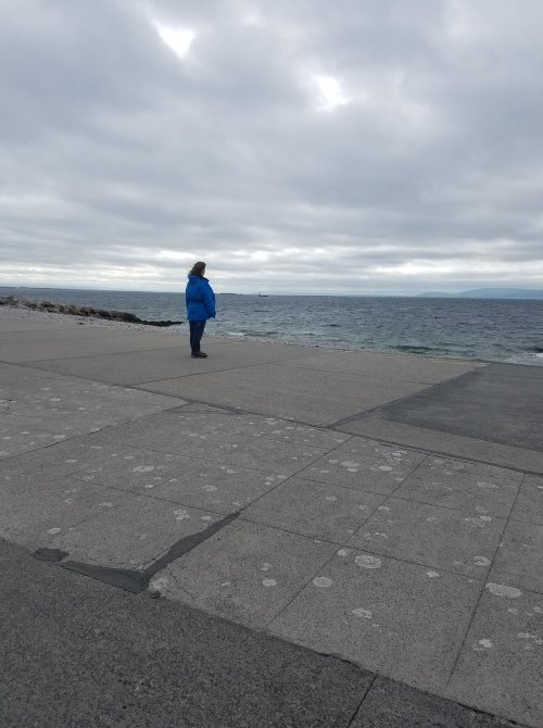 Me looking at Atlantic Ocean in my raincoat