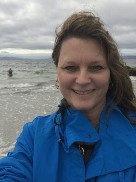 me in my blue rain jacket in Galway on the beach