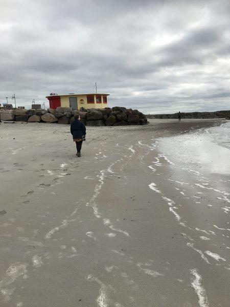 Leah walking on the beach