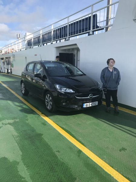 Leah by our car on the ferry in Kerry County